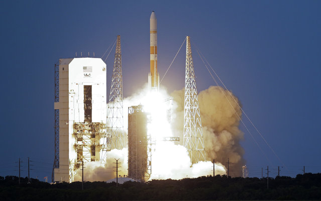 A United Launch Alliance Delta 4 rocket, carrying the seventh Wideband Global SATCOM military communications satellite, lifts off from launch complex 37 at the Cape Canaveral Air Force Station, Thursday, July 23, 2015, in Cape Canaveral, Fla. (Photo by John Raoux/AP Photo)