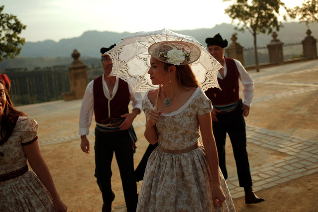 """People, dressed as bandits and bourgeoises, walk as they participate in the fifth edition of """"Ronda Romantica"""" (Romantic Ronda) in Ronda, southern Spain, May 27, 2017. (Photo by Jon Nazca/Reuters)"""