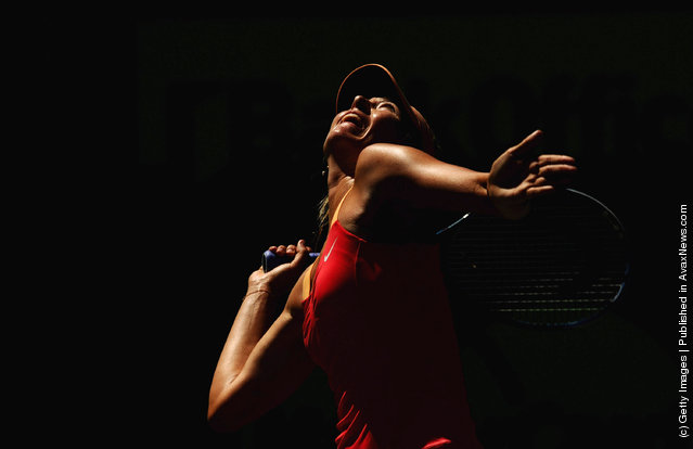 Maria Sharapova of Russia serves during her match against Ekaterina Makarova of Russia on day 8 of the Sony Ericsson Open at Crandon Park Tennis Center