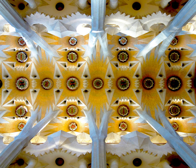 """Inside Barcelona"". I was inside the Temple of Sagrada Familia – one of the approximately 3 million visitors to the church each year. Several ""trees"" made me follow their trunks upward with my eyes. At the top I saw this kaleidoscope of colors that somehow grounded me. I took the same shot that I suspect many others have also taken. And yet, for each of us, because of the experience of just being there, our personal photo is truly personal. Photo location: Barcelona, Spain. (Photo and caption by Patrick Flaherty/National Geographic Photo Contest)"