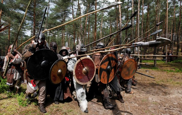 "Participants dressed as characters such as elves, dwarves, goblins and orcs from the J.R.R. Tolkien's novel ""The Hobbit"" re-enact the ""Battle of Five Armies"" in a forest near the town of Doksy, Czech Republic, June 4, 2016. (Photo by David W. Cerny/Reuters)"