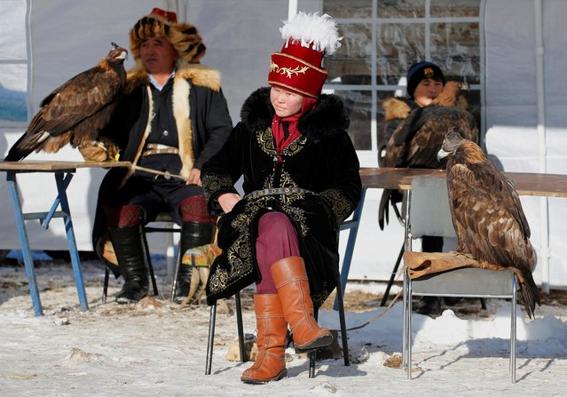 Hunters with their tamed golden eagles take part in a traditional hunting contest outside the village of Kaynar in Almaty region, Kazakhstan on December 8, 2019. (Photo by Pavel Mikheyev/Reuters)