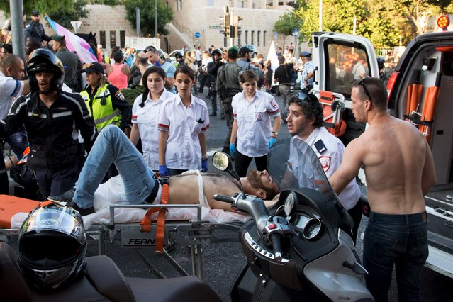 A participant of an annual gay pride parade is treated after an Orthodox Jewish assailant stabbed and injured six participants in Jerusalem on Thursday, police and witnesses said July 30, 2015. (Photo by Carsten Seibold/Reuters)