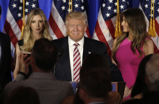 Republican U.S. presidential candidate Donald Trump speaks while accompanied by his daughter Ivanka (L) and wife Melania (R) at a campaign event on the day that several states held presidential primary elections, including California, at the Trump National Golf Club Westchester in Briarcliff Manor, New York, U.S., June 7, 2016. (Photo by Mike Segar/Reuters)