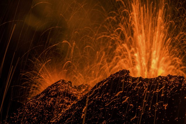 Molten lava erupts from the Piton de la Fournaise, one of the world's most active volcanoes, in this picture taken July 31, 2015, on French Indian Ocean Reunion Island. (Photo by Gilles Adt/Reuters)
