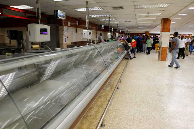 An empty refrigerator is seen inside a supermarket in Caracas, Venezuela, June 10, 2016. (Photo by Ivan Alvarado/Reuters)