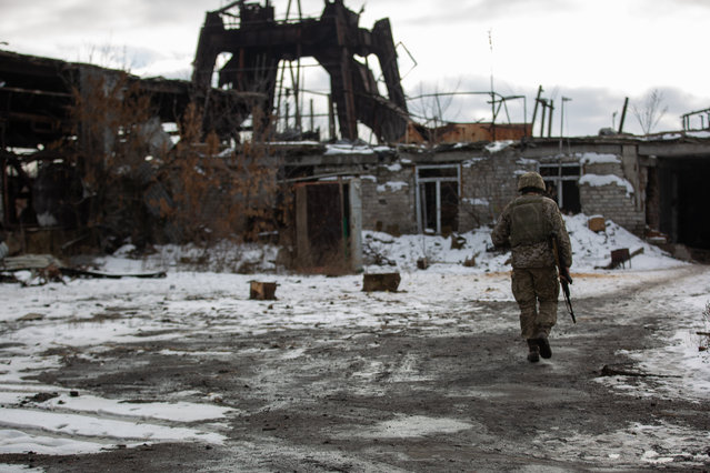 A Ukrainian soldier walks through destroyed mines in Butovka in Ukraine's Donetsk region on December 7, 2019. (Photo by Andriy Dubchak/Radio Free Europe/Radio Liberty)