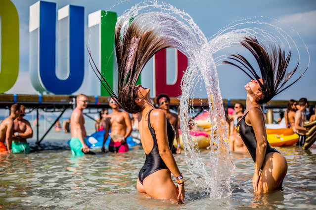 Girls play in the water during the Balaton Sound music festival held on the shore of lake Balaton in Zamardi, west Hungary, on July 9, 2017. (Photo by Sandor Csudai/Rockstar Photographers)