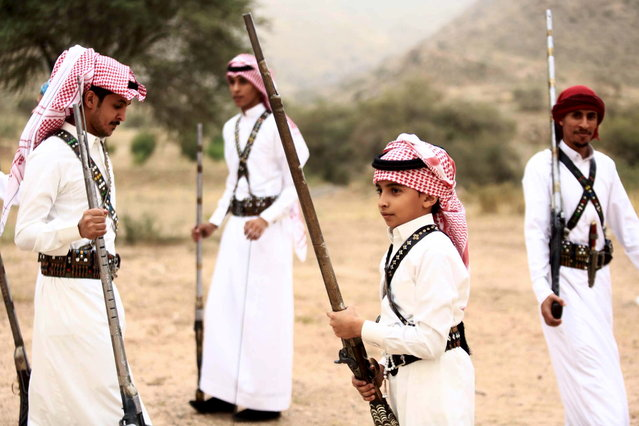 People pose for a photo during a traditional excursion near the western Saudi city of Taif, August 8, 2015. (Photo by Mohamed Al Hwaity/Reuters)