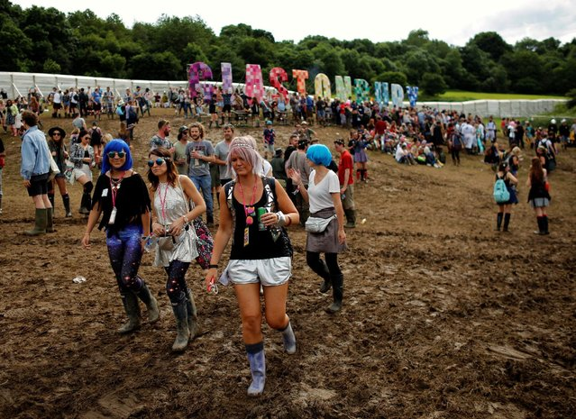 Revellers walk in a muddy field during the Glastonbury Festival at Worthy Farm in Somerset, Britain, June 23, 2016. (Photo by Stoyan Nenov/Reuters)