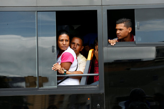 People take a ride on a bus in Caracas, Venezuela, June 21, 2016. (Photo by Mariana Bazo/Reuters)