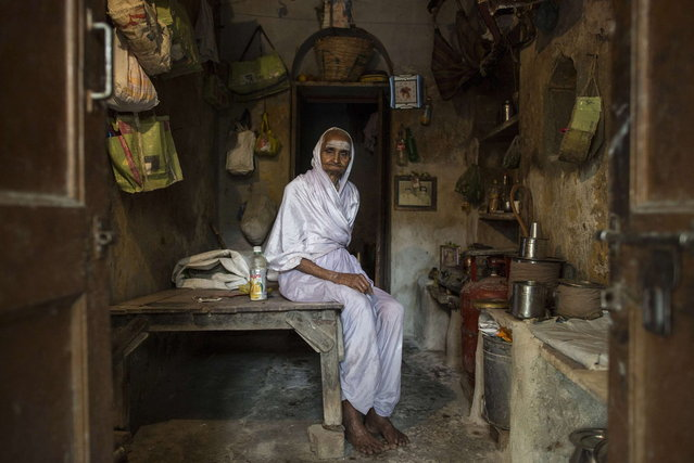 Savitri, an 80-year-old widow, poses for a photograph inside her room at Mumukshu Bhavan (Home of the Ailing) in Varanasi, in the northern Indian state of Uttar Pradesh, June 19, 2014. (Photo by Danish Siddiqui/Reuters)
