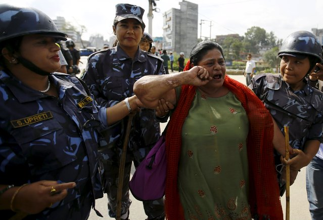 Nepalese police detain a protester during a general strike organised by a 30-party alliance led by a hardline faction of former Maoist rebels, who are protesting against the draft of the new constitution, in Kathmandu, Nepal August 16, 2015. The group says that the draft is not inclusive and does not protect the rights of marginalised and underprivileged groups in the country. (Photo by Navesh Chitrakar/Reuters)