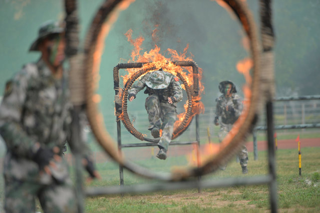 Soldiers of People's Liberation Army (PLA) take part in a training in Shijiazhuang, Hebei province, June 29, 2016. (Photo by Reuters/Stringer)