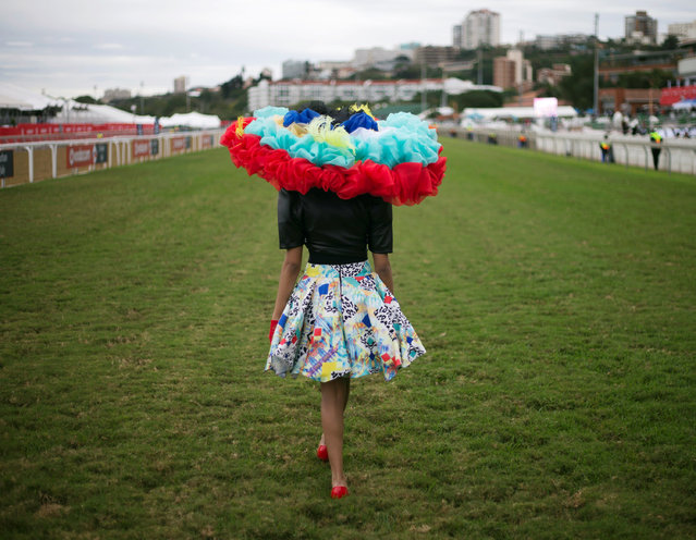 A person poses on the track during a fashion competition at the Durban July horse racing event in Durban, South Africa, July 2, 2016. (Photo by Rogan Ward/Reuters)