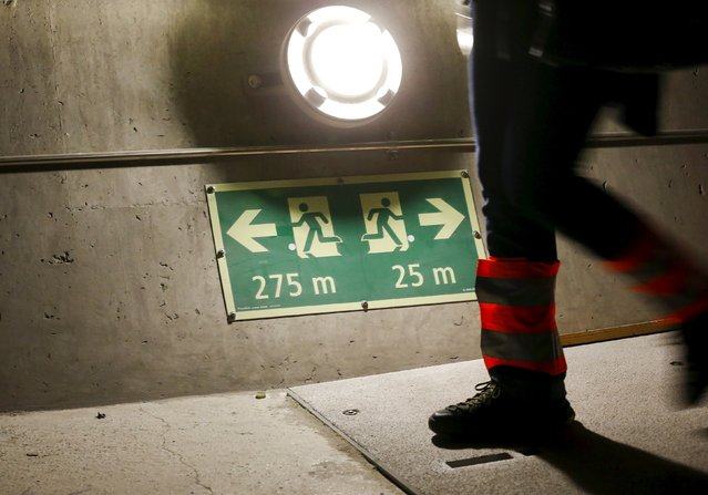 A journalist walks past a sign showing the distance to the next emergency exit at the NEAT Gotthard Base Tunnel, during a media visit near the town of Sedrun August 24, 2015. (Photo by Arnd Wiegmann/Reuters)