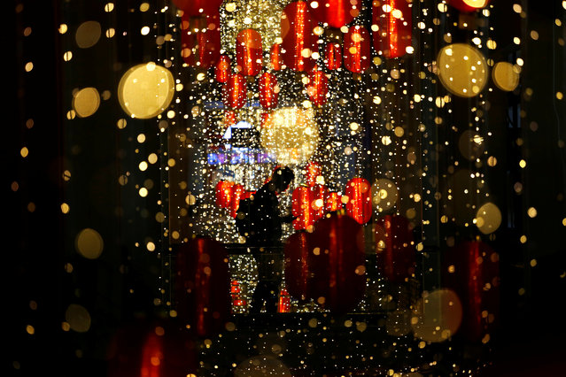 A man walks past Chinese Lunar New Year lanterns at a shopping mall in Jakarta, Indonesia, January 26, 2020. (Photo by Ajeng Dinar Ulfiana/Reuters)