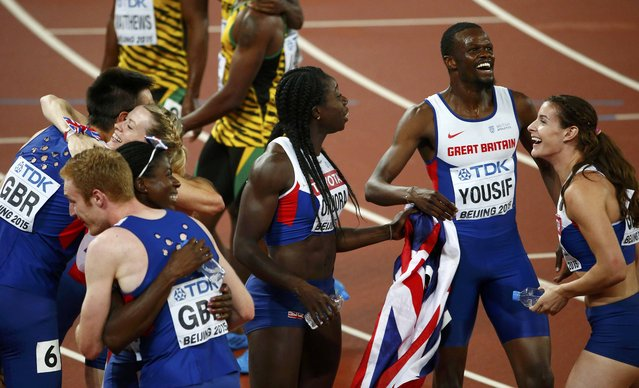 The British men's and women's teams celebrate after finishing third in the 4 x 400 metres relay finals during the 15th IAAF World Championships at the National Stadium in Beijing, China August 30, 2015. (Photo by David Gray/Reuters)