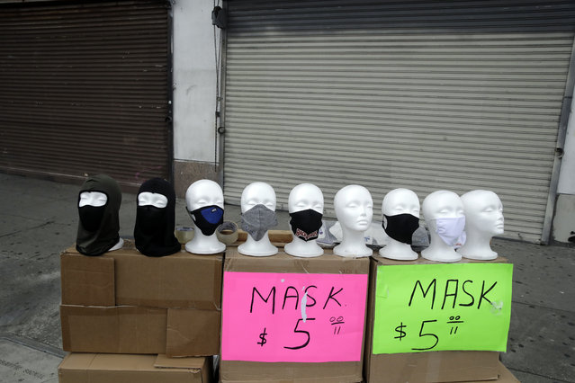 Masks are sold on a street corner Sunday, April 5, 2020, amid the coronavirus pandemic in Los Angeles. California Gov. Gavin Newsom on Saturday praised the state's counties for agreeing, on a case-by-case basis, to cancel property-tax penalties for homeowners, small businesses and other property owners who have a demonstrated economic hardship. (Photo by Marcio Jose Sanchez/AP Photo)