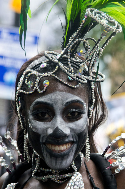 Members of the London Samba School perform during the parade at Notting Hill Carnival on August 31, 2015 in London, England. The Carnival, the largest in Europe, is a street party that takes place on the streets of Notting Hill. It is Caribbean themed and millions of people annually attend the event. (Photo by Ben A. Pruchnie/Getty Images)