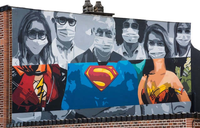 """Illustration picture shows  a graffiti with nurses and doctors depicted as superheroes, by artist Jurgen Massage """"Massi"""" based on a picture by photographer Ugur Gallen, in Sint-Martens-Lennik, Friday 10 April 2020. Belgium is in its fourth week of confinement in the ongoing corona virus crisis. The measures announced on March 18th by the National Security Council to avoid the spread of the Covid-19 will remain active until April 19th and might be prolonged after that. (Photo by SIPA Press/Rex Features/Shutterstock)"""