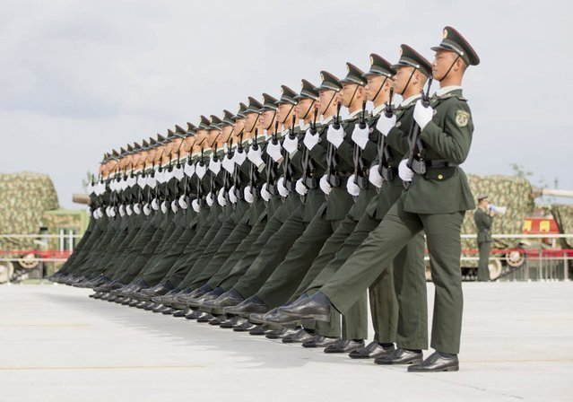 Soldiers of China's People's Liberation Army march with their weapons during a training session for a military parade to mark the 70th anniversary of the end of World War Two, at a military base in Beijing, China, September 1, 2015. (Photo by Reuters/Stringer)