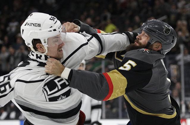 Los Angeles Kings defenseman Kurtis MacDermid, left, fights with Vegas Golden Knights defenseman Deryk Engelland during the first period of an NHL preseason hockey game Tuesday, Sept. 26, 2017, in Las Vegas. (Photo by John Locher/AP Photo)