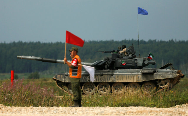 A T-72 tank, operated by a crew from Kuwait, is seen during the Tank Biathlon competition, part of the International Army Games 2016, at a range in the settlement of Alabino outside Moscow, Russia, August 2, 2016. (Photo by Maxim Shemetov/Reuters)