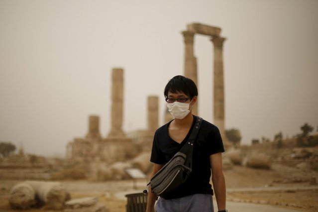 A tourist wearing a face mask walks at the Amman Citadel, during a sandstorm in downtown Amman, Jordan, September 8, 2015. (Photo by Muhammad Hamed/Reuters)