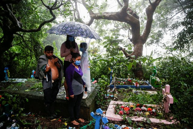 Relatives take part in the funeral of Fredy Amilcar Gomez Blanco and Jason Eulises Gomez Gomez, who died after they were dragged by river flooding caused by Tropical Storm Amanda, in Santa Tecla, El Salvador on June 4, 2020. (Photo by Jose Cabezas/Reuters)