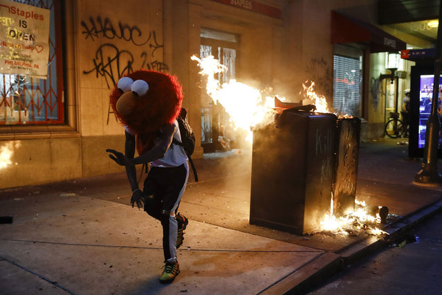 A protester in an Elmo mask dances during the Justice for George Floyd Philadelphia Protest on Saturday, May 30, 2020. Demonstrators took to the streets across the United States to protest the death of Floyd, a black man who was killed in police custody in Minneapolis on May 25. (Photo by Matt Rourke/AP Photo)