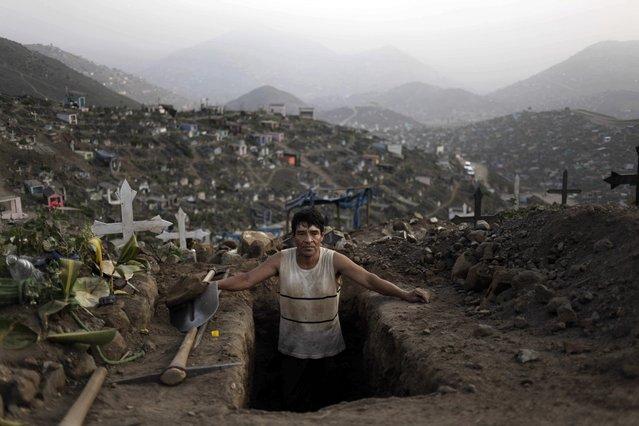 "FILE- In this Sept. 9, 2013 file photo, grave digger Juan Luis Cabrera takes a break from his work at the ""Nueva Esperanza"" cemetery in Lima, Peru. (AP Photo/Rodrigo Abd, File)"