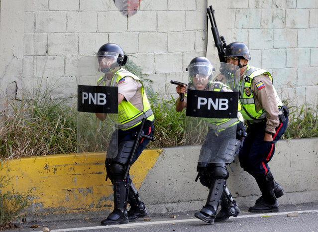 Riot police clash with protesters during a rally to demand a referendum to remove Venezuela's President Nicolas Maduro in Caracas, Venezuela, September 1, 2016. (Photo by Marco Bello/Reuters)