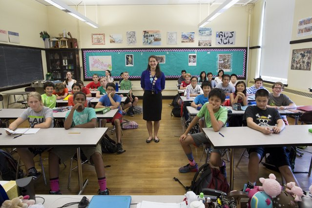 Teacher Elizabeth Moguel poses for a photograph with her seventh grade Latin class at Boston Latin School in Boston, Massachusetts September 17, 2015. Boston Latin School is the first and oldest public school in the U.S, founded in 1635. (Photo by Brian Snyder/Reuters)