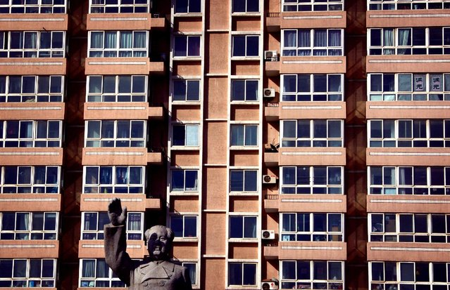 A statue of the former Chinese chairman Mao Zedong stands in front of an apartment building in the Miyun county, 60 kilometres (40 miles) north of Beijing January 31, 2012. (Photo by David Gray/Reuters)