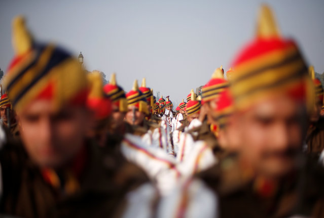 Soldiers rest after their rehearsal for the Republic Day parade on a winter morning in New Delhi, January 8, 2018. (Photo by Adnan Abidi/Reuters)
