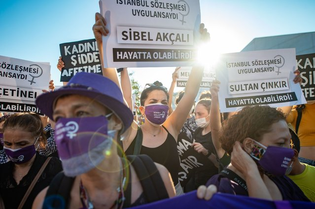 Demonstrators wearing protective face masks hold up placards during a demonstration for a better implementation of the Istanbul Convention and the Turkish Law 6284 for the protection of the family and prevention of violence against women, in Istanbul, Turkey, on August 5, 2020. (Photo by Yasin Akgul/AFP Photo)
