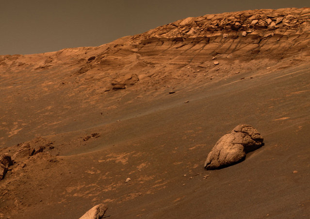 An image taken by Opportunity on October 7, 2004, shows a bizarre, lumpy rock informally named Wopmay on the lower slopes of Endurance Crater. Scientists believe the lumps in Wopmay were formed by one of two processes. Either they were caused by the impact that created the football field-sized crater, or they arose when water soaking the rock dried up. (Photo by AP Photo/NASA/The Atlantic)