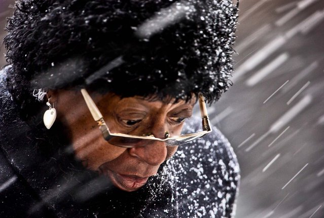 A woman crosses Market Street during a winter snow storm in Philadelphia, March 8, 2013. Many areas in the state reported 4 to 6 inches of snow. (Photo by Matt Rourke/Associated Press)