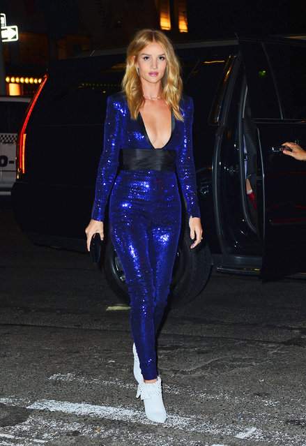 Rosie Huntington-Whiteley looks striking in a sparkling jumpsuit as she steps out during NYFW in NYC on February 10, 2018. (Photo by Splash News and Pictures)