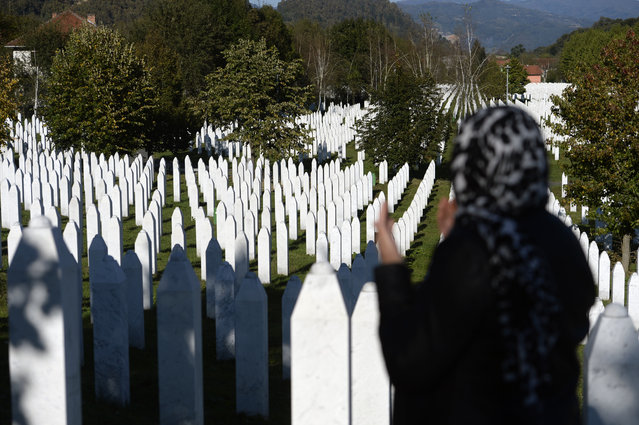 "A woman prays at the memorial cemetery in Potocari, after the first public showing of Bosnian filmmaker Jasmila Zbanic's film on the 1995 massacre in Srebrenica – ""Quo Vadis, Aida?"", in the eastern Bosnian town of Srebrenica, October 10, 2020. The Srebrenica massacre was the culmination of Bosnia's 1992-95 war, which pitted the country's three main ethnic factions – Serbs, Croats and Bosnian Muslims. (Photo by Kemal Softic/AP Photo)"
