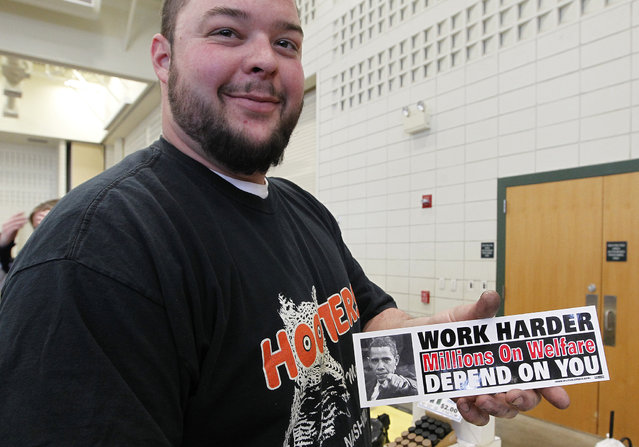 Jim Green of Hartford shows a bumper sticker he plans on buying at the Washington County Fairgrounds Gun Show, on March 22, 2013. The show drew thousands of people over the weekend. (Photo by Gary Porter)