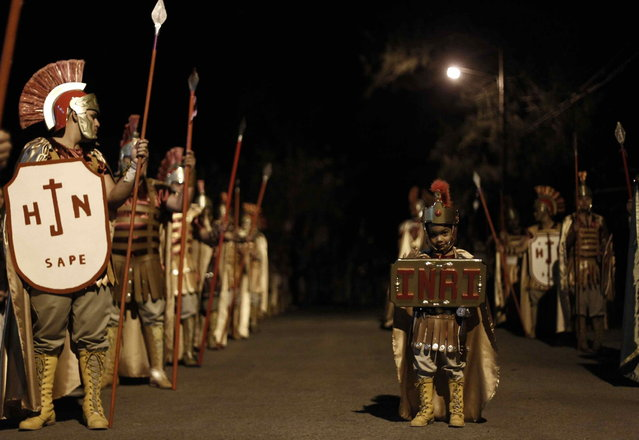 A boy dressed up as a Roman soldier takes part in a procession during Holy Week, in Tapachula, near San Jose, Costa Rica, on March 27, 2013. Holy Week is celebrated in many Christian traditions during the week before Easter. (Photo by Juan Carlos Ulate/Reuters)