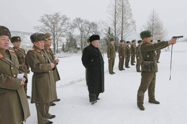 North Korean leader Kim Jong Un (C) stands in the snow as he inspects KPA Unit 1313 honored with the title of O Jung Hup-led 7th Regiment in this undated photo released by North Korea's Korean Central News Agency (KCNA) in Pyongyang December 5, 2014. (Photo by Reuters/KCNA)