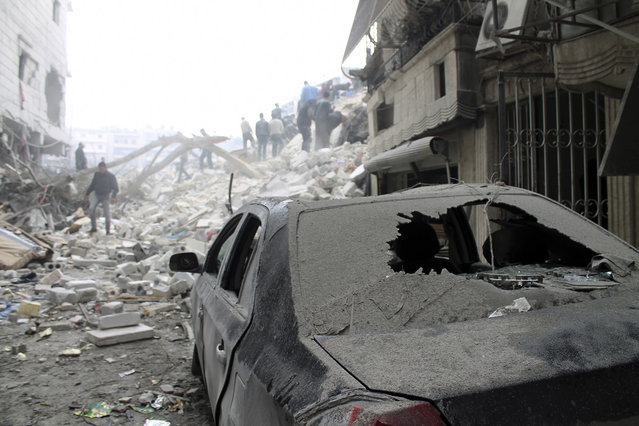 A damaged car in rubble in Al-Ansari neighborhood after what activists said was a missile attack by Syrian Air Forces in Aleppo, on February 3, 2013. (Photo by Aaref Hretani/Reuters /The Atlantic)