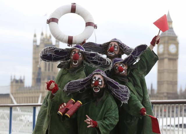 Clowns from Slava's Snowshow pose for photographers on London's South Bank, December 17, 2014.The show will take place at London's Royal Festival Hall from December 17 through to January 5, 2015. (Photo by Paul Hackett/Reuters)