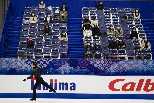 Spectators watch Sena Miyake of Japan warm up during a practice session of an ISU Grand Prix of Figure Skating competition in Kadoma near Osaka, Japan, Friday, November 27, 2020. The event was held with limited spectator attendance Friday. (Photo by Hiro Komae/AP Photo)