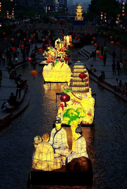 Lanterns are displayed to celebrate Buddha's birthday along a stream in Seoul. (Photo by Ahn Young-joon/Associated Press)
