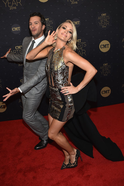 Honoree's Luke Bryan (L) and Carrie Underwood (R) arrive on the red carpet at CMT Artists of the Year 2016 on October 19, 2016 in Nashville, Tennessee. (Photo by John Shearer/Getty Images for CMT)