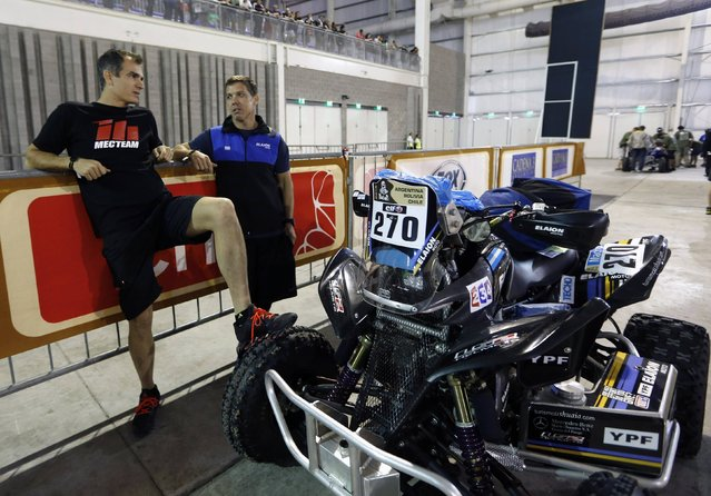 Argentine riders Honda's Daniel Domaszewski (R) and Yamaha's Pablo Copetti talk with while waiting for technical verification ahead of the Dakar Rally 2015 in Buenos Aires January 1, 2015. (Photo by Enrique Marcarian/Reuters)